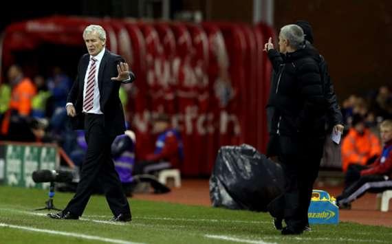 Stoke City boss Mark Hughes and Chelsea manager Jose Mourinho