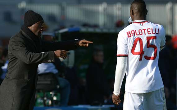 Milan coach Clarence Seedorf (L) and striker Mario Balotelli