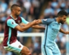 Winston Reid and Sergio Aguero contend for possession