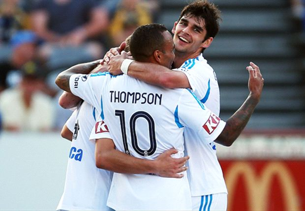 Gui Finkler and Archie Thompson celebrate a Victory goal