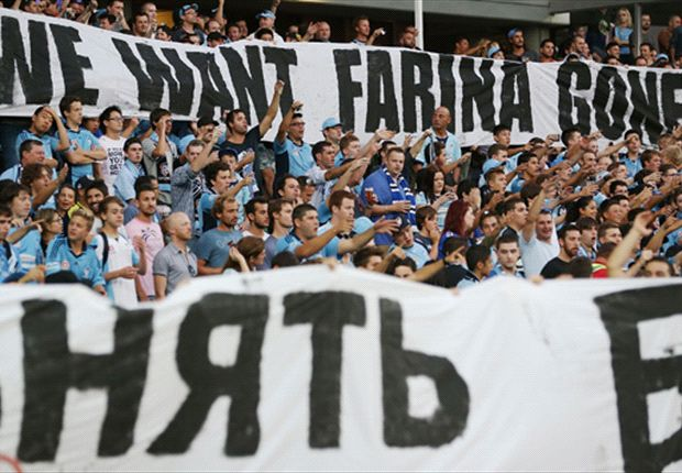 Supporters in 'The Cove' display banners calling for the coach to go