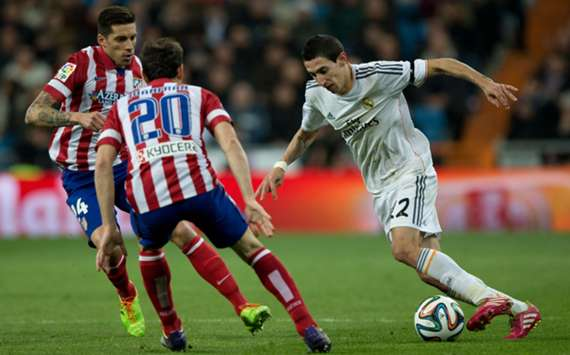 Atletico Madrid and Real Madrid in action