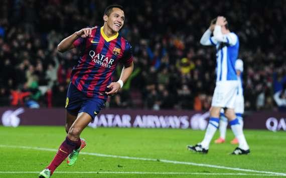 Alexis Sanchez celebrates scoring against Real Sociedad