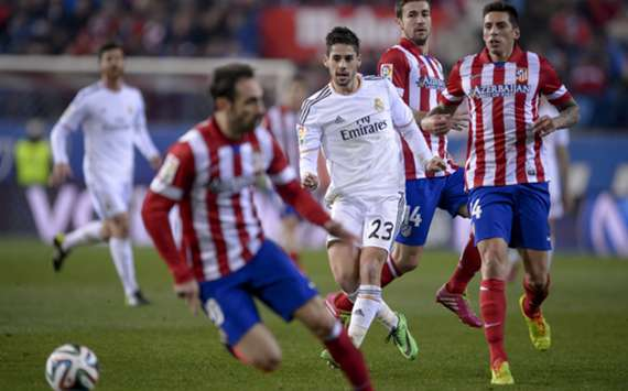 Atletico and Real Madrid battle