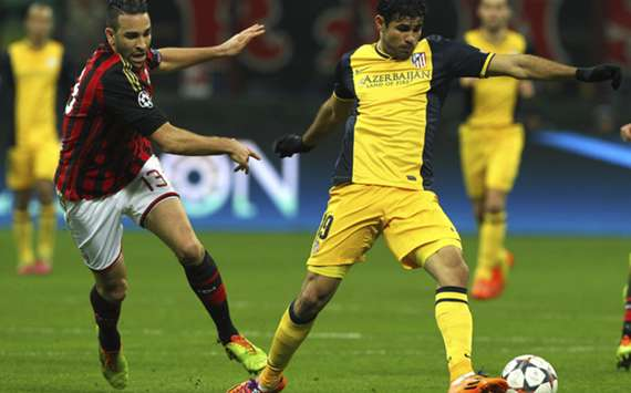 Milan's Adil Rami (L) tussles with Diego Costa