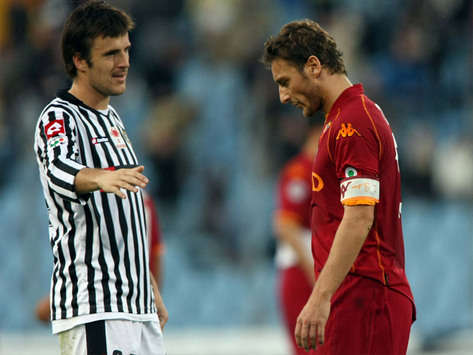 Udinese's Aleksandar Lukovic consoles Francesco Totti after yet another Roma defeat