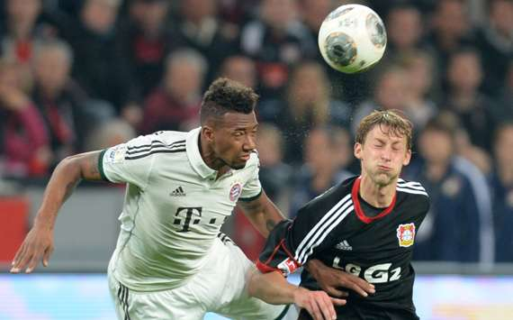 Stefan Kiessling (R) competes with Bayern Munich defender Jerome Boateng