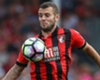 Howe laments Wilshere absence