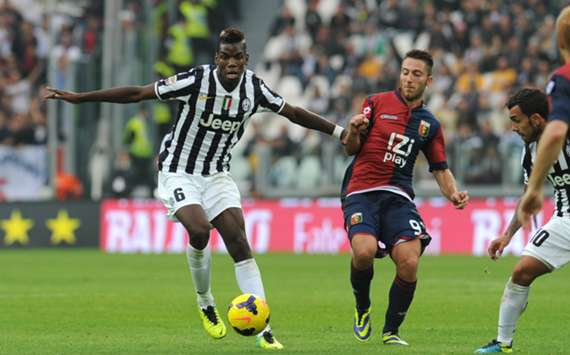 Juventus and Genoa players battle