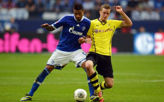 Dortmund and Schalke players battle