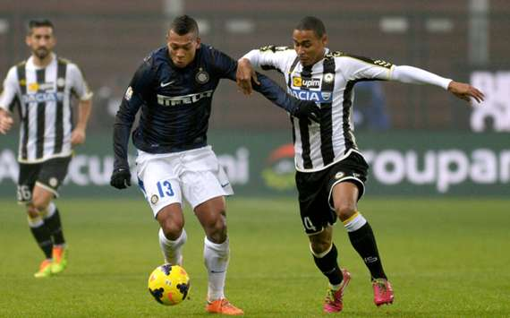 Inter and Udinese players battle