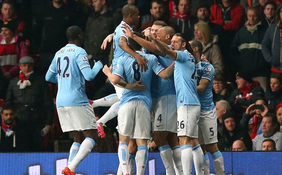 Manchester City paints Old Trafford Blue