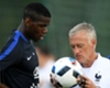 Deschamps cools Pogba expectations