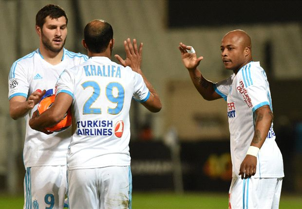 Andre-Pierre Gignac and Andre Ayew celebrate