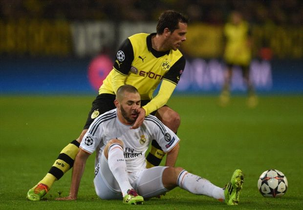 BVB's Friedrich vies for the ball with Real Madrid's Karim Benzema