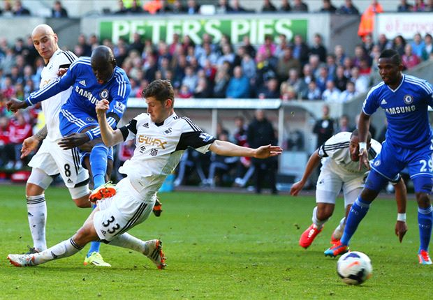 Four wins needed to claim Premier League title - Holland