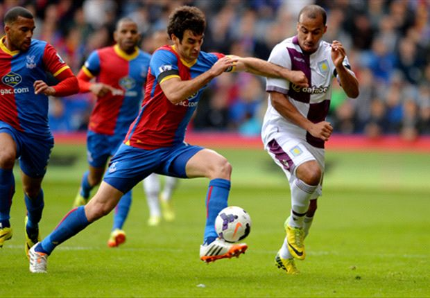 Crystal Palace's Mile Jedinak up against Gabriel Agbonlahor