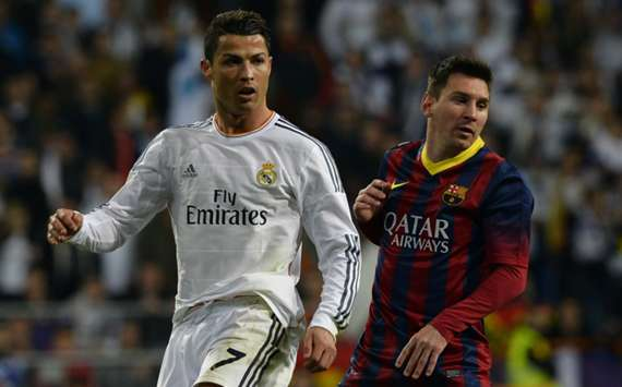 Real Madrid's Cristiano Ronaldo (L) and Barcelona's Lionel Messi