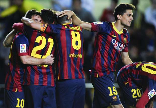 Barcelona players celebrate a Lionel Messi goal