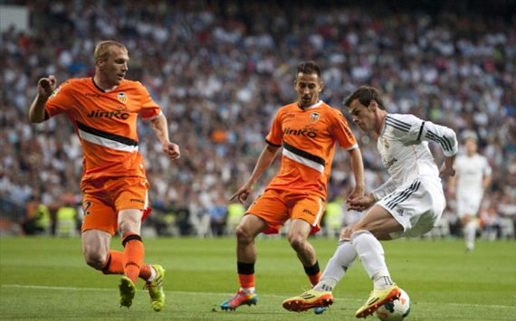 Bale controls the ball in front of Mathieu