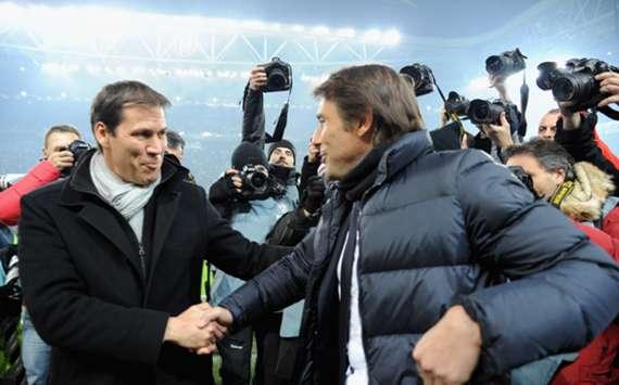 Roma coach Rudi Garcia (L) and Juventus' Antonio Conte