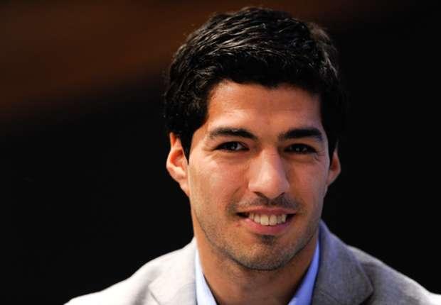 Suarez 'so happy' at Liverpool despite transfer rumours