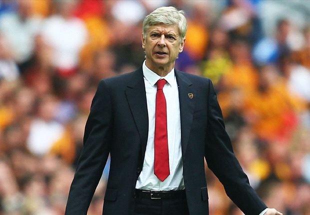 Wenger vows to stay at Arsenal after FA Cup win