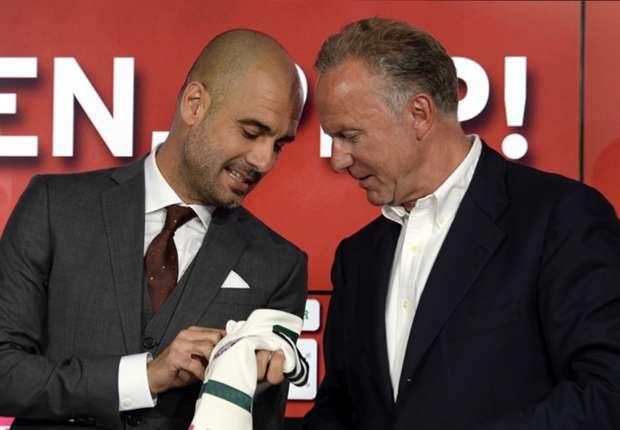 Pep Guardiola (L) and Bayern Munich's chairman Karl-Heinz Rummenigge