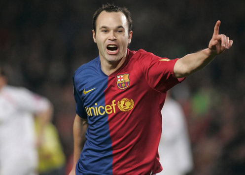 Andres Iniesta celebrated his return to the Barcelona first-team by scoring in their 3-1 win over Mallorca.