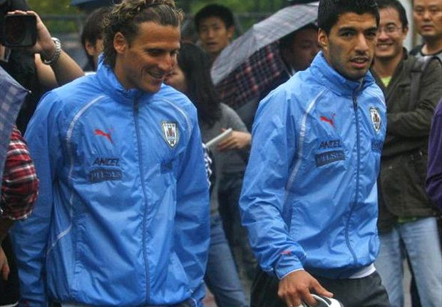 Luis Suarez is very happy at Liverpool, says Forlan