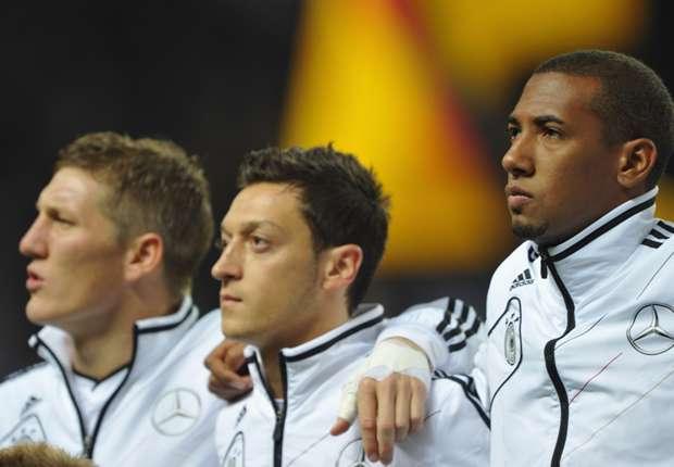 Germany team-mates Mesut Ozil (C) and Jerome Boateng (R)