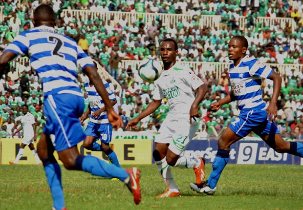 Gor Mahia striker Rama Salim battles Bernard Mang'oli of AFC Leopards.