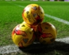 Three footballs used in a pre-game warm-up