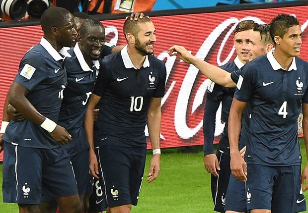 Karim Benzema celebrates after netting his second and France's third.