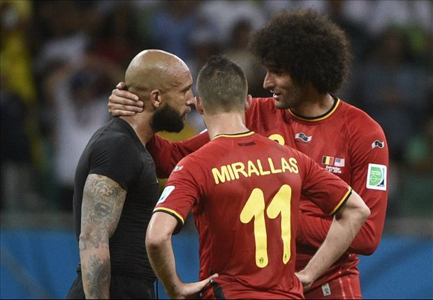 Marouane Fellaini and Kevin Mirallas console USA goalkeeper Tim Howard.
