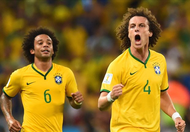 Brazil 2-1 Colombia: David Luiz wonderstrike sends hosts through as Neymar is stretchered off