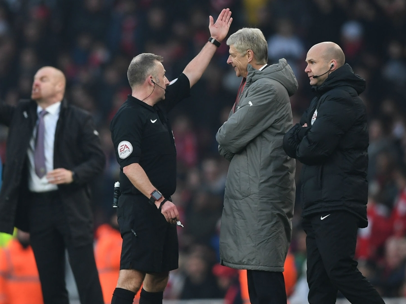 Angry Wenger pushes fourth official after being sent down tunnel by ref Moss