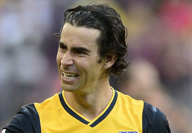 Tiago signs new Atletico deal