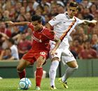 Agger own goal seals defeat for Liverpool