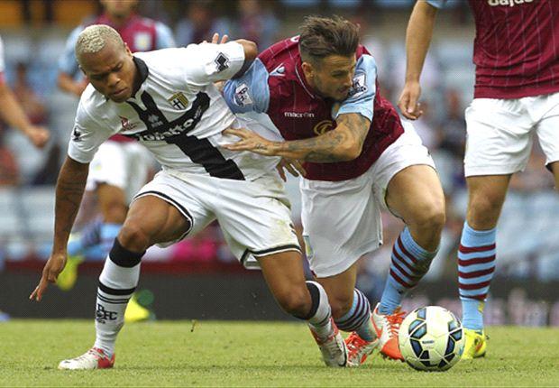 Aston Villa's Chris Herd up against Parma
