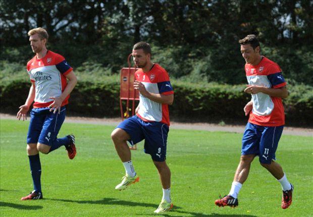 Ozil, Mertesacker and Podolski back in Arsenal training