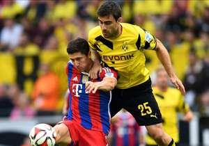 Dortmund's Sokratis challenges Bayern's Lewandowski, Supercup