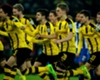 Borussia Dortmund rush to celebrate their DFB-Pokal shootout win over Hertha Berlin