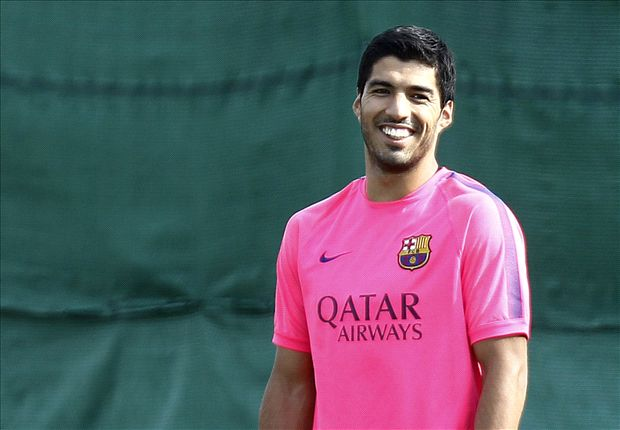 Suarez begins training with Barca