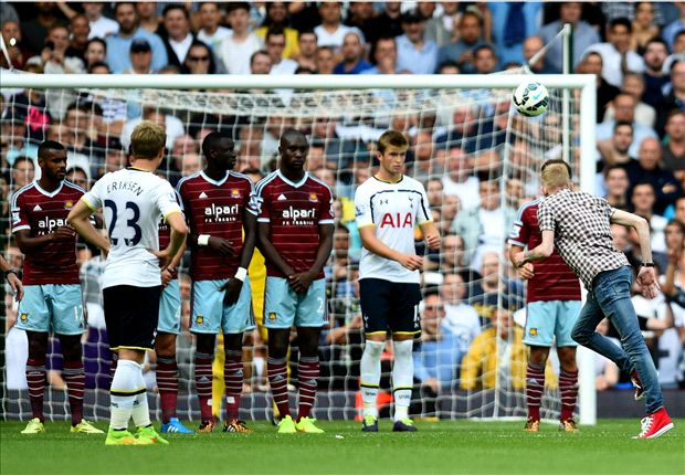 Pitch invader takes free-kick during Tottenham's win over West Ham