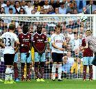 Pitch invader takes Tottenham's free-kick