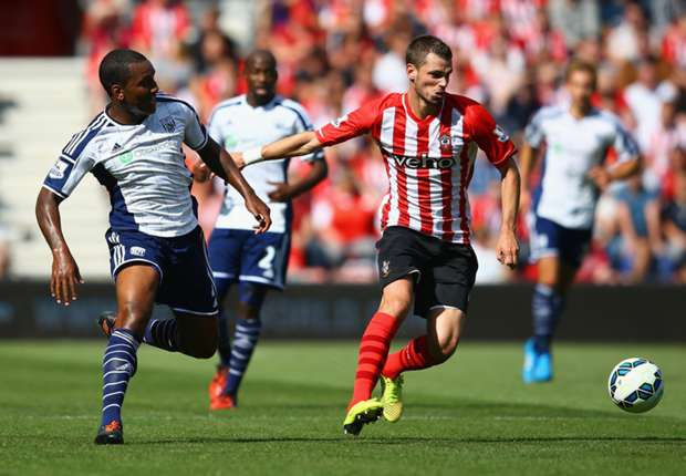 West Brom's Andre Wisdom (L) and Southampton midfielder Morgan Schneiderlin