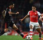 Alexis sends 10-man Arsenal through