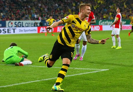 Dortmund hold on in five-goal thriller