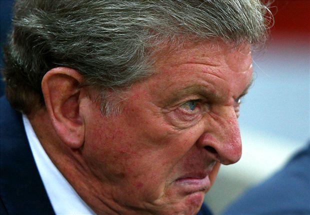 Furious Hodgson defends England display